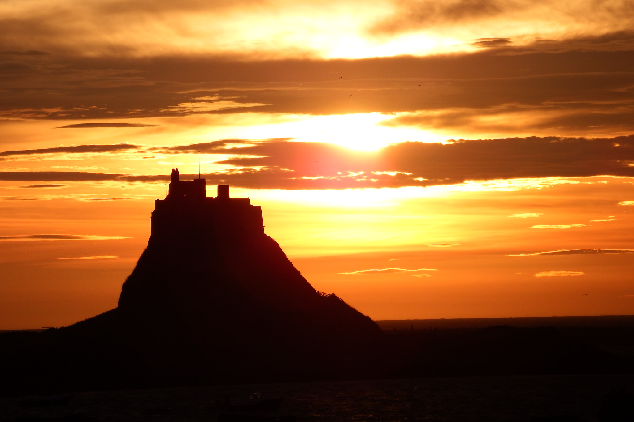 Lindisfarne at sunset. Photograph by Richard Twinch