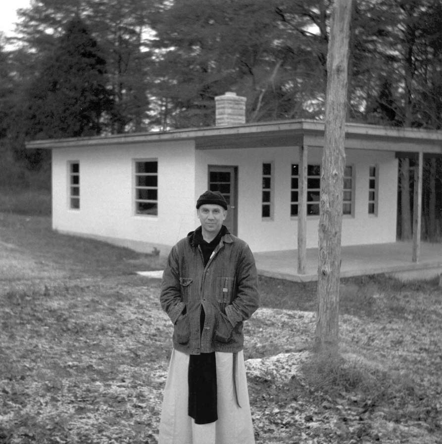 Merton outside the Hermitage in the grounds of Gethsemani Abbey. Used with permission of the Merton Legacy Trust and the Thomas Merton Center at Bellarmine University