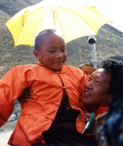 Enthronement Young 17th Karmapa in Akong Rinpoche's arms