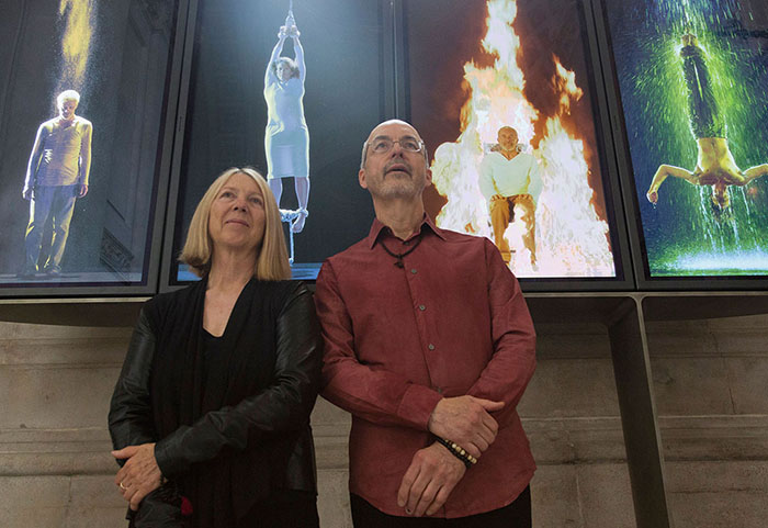 Bill Viola and Kira Perov in front of the permanent video installation Martyrs