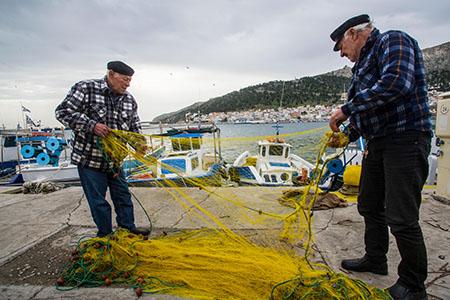 Fishermen on the harbour at Kalymnos, Greece