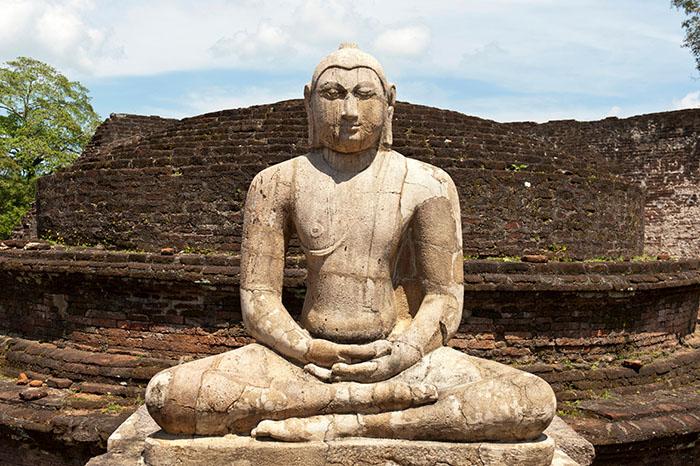 Seated Buddha statue made of stone in a meditation posture, Polonnaruwa, Sri Lanka